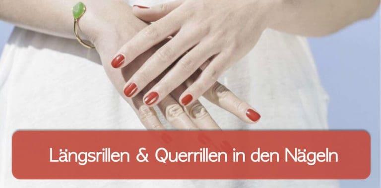 Hände und Fingernägel mit rotem Nagellack