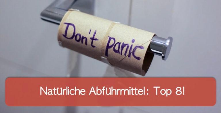 """Leere Toilettenpapierrolle mit der Aufschrift """"Don't panic"""""""
